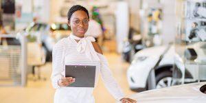 dealer floor plan woman and car